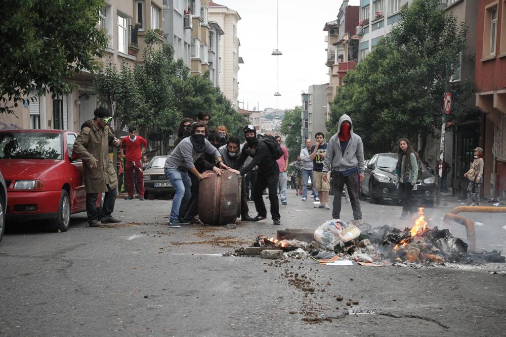 Taksim Square Protest Crowd Blocking road Fire TURKEY