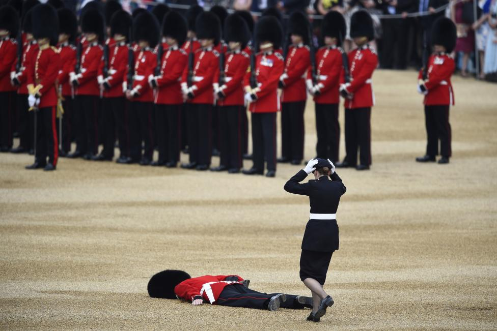 A Guardsman faints at Horseguards Parade for the annual Trooping the Colour ceremony in central London, Britain June 11, 2016. Trooping the Colour is a ceremony to honour Queen Elizabeth's official birthday. The Queen celebrates her 90th birthday this year. REUTERS/Dylan Martinez