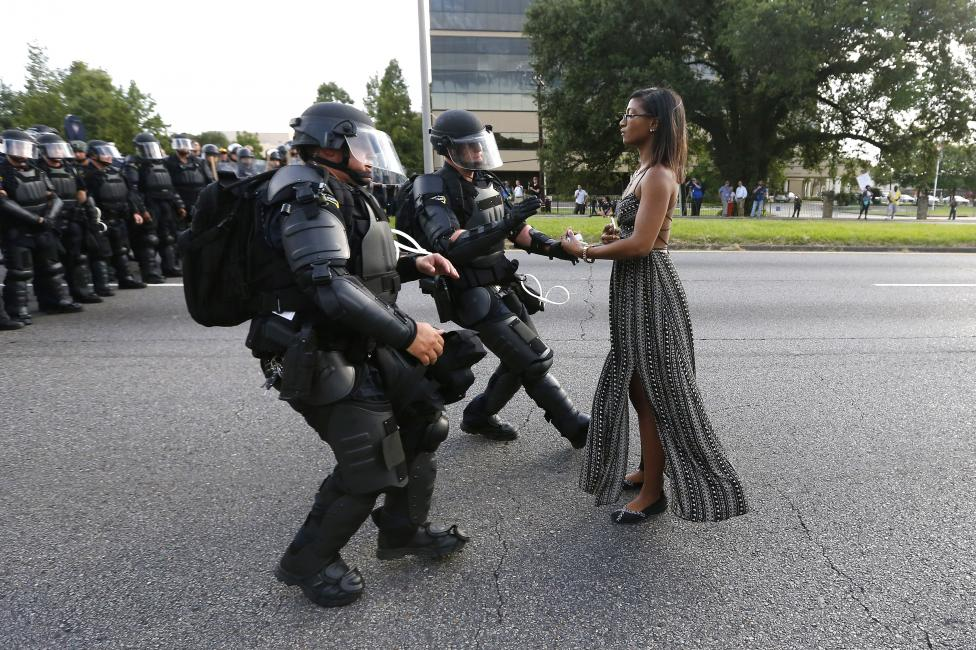 Protester Ieshia Evans is detained by law enforcement near the headquarters of the Baton Rouge Police Department in Baton Rouge, Louisiana, during a demonstration against the shooting death of Alton Sterling July 9, 2016. REUTERS/Jonathan Bachman