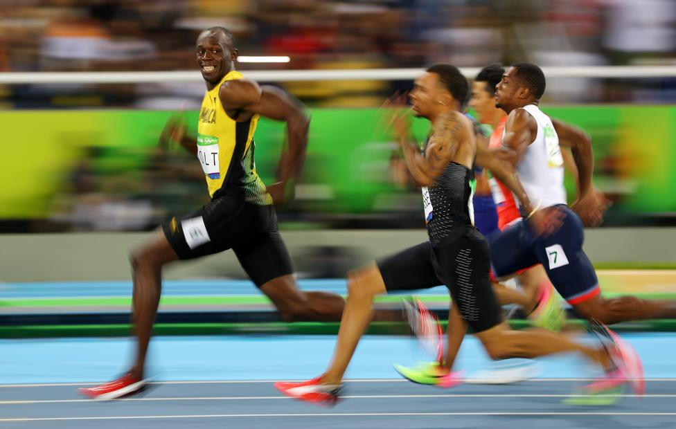 Usain Bolt of Jamaica looks at Andre De Grasse of Canada as they compete in the men's 100m semifinals at the Rio Olympics August 14, 2016. REUTERS/Kai Pfaffenbach