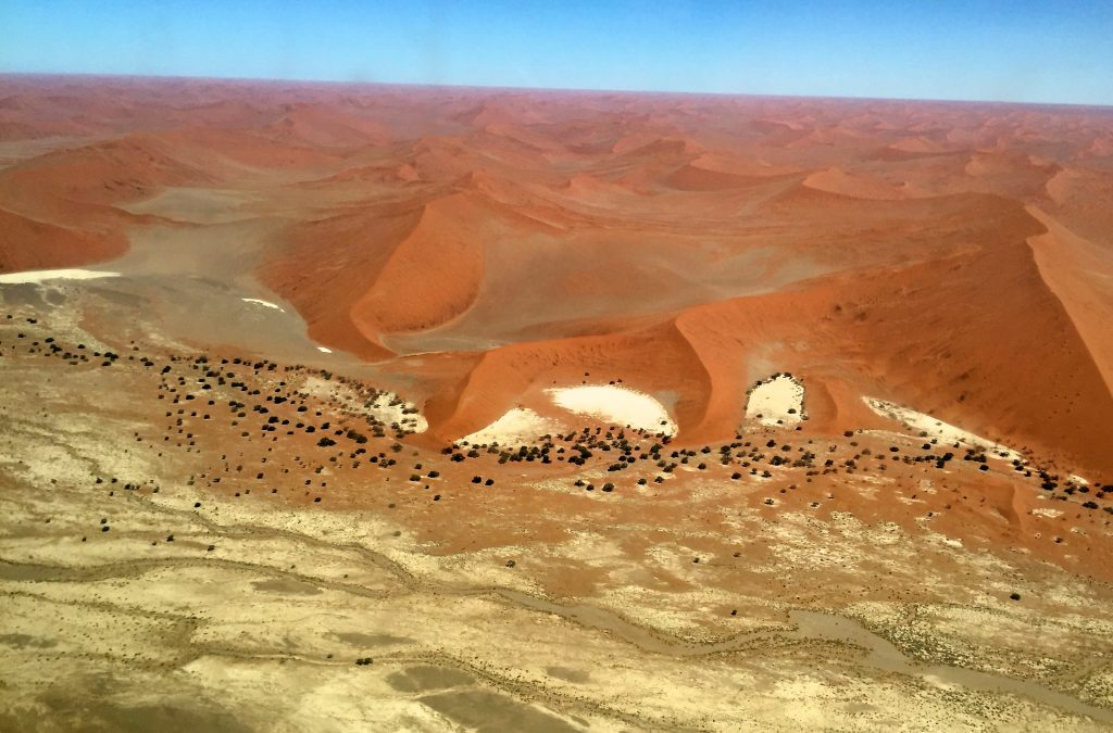 Flying over Sossusvlei, a sea of red sand dunes