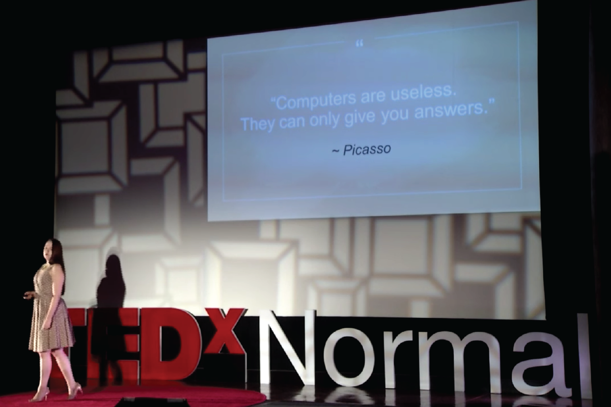 Packback cofounder Jessica Tenuta speaking on the TEDxNormal stage.