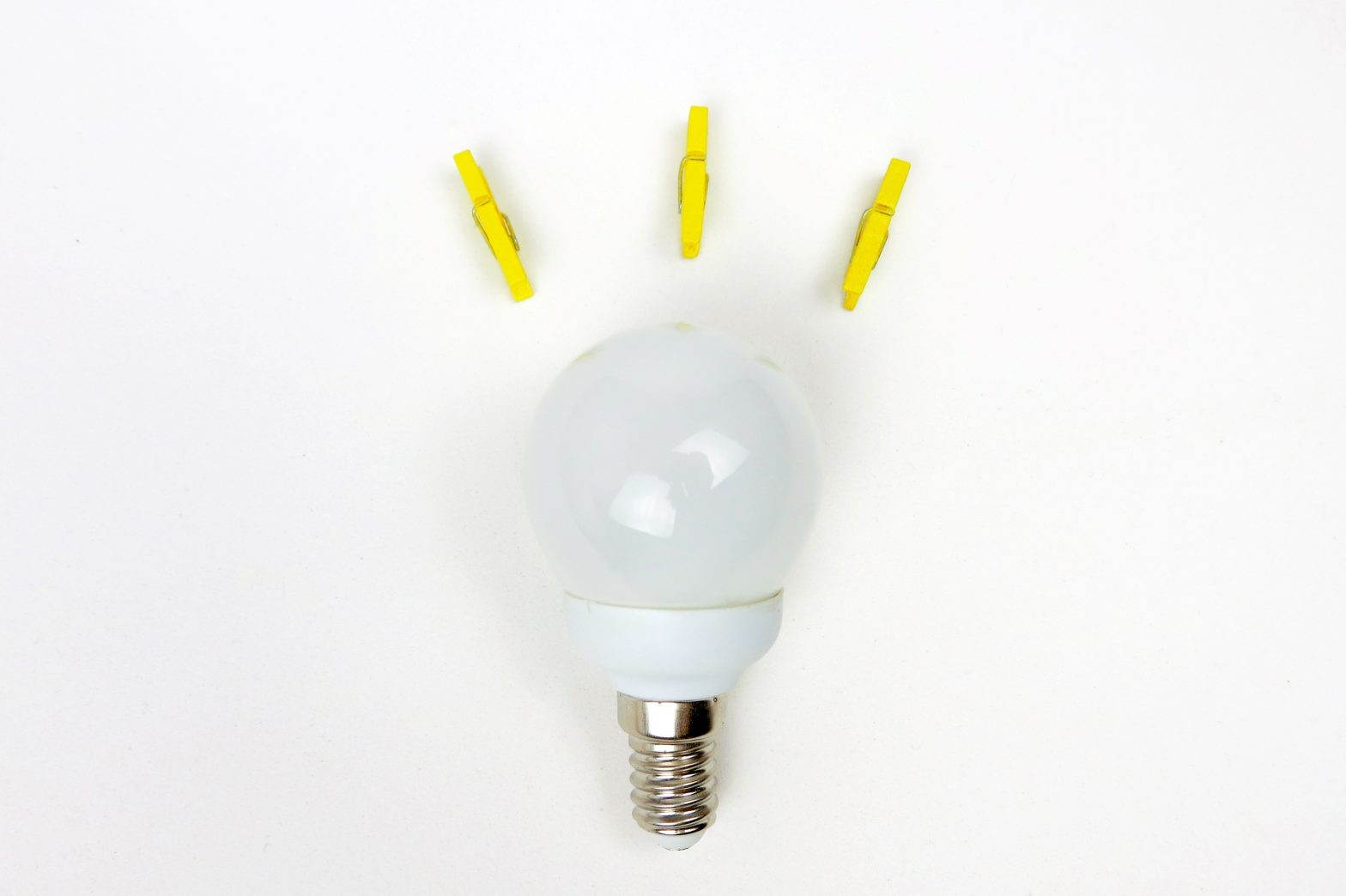 Light bulb with yellow clips