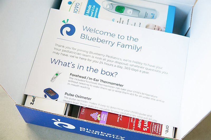 picture of 'pediatrician office in-a-box' toolkit, which includes a smart otoscope, pulse oximeter, and a forehead/ear thermometer
