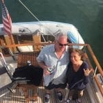 Karen Papa with husband on a boat blue beyond consulting bay area