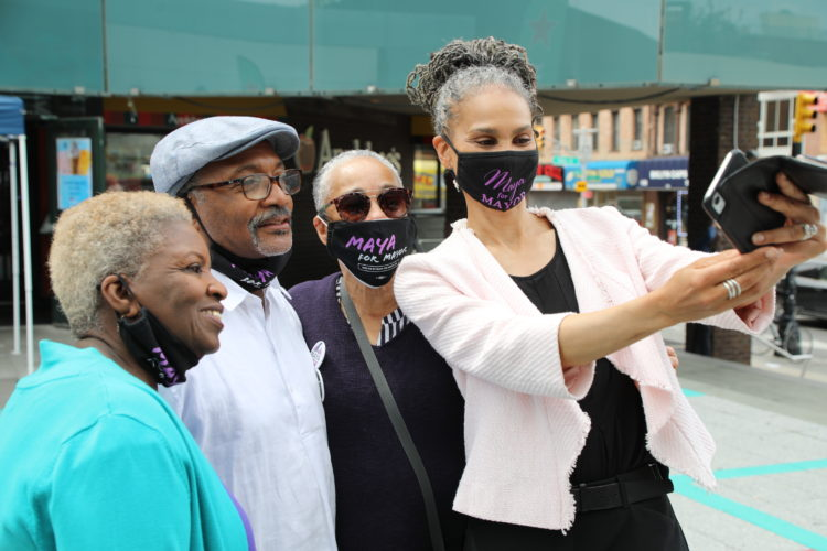 Maya Wiley takes a selfie with three older supporters
