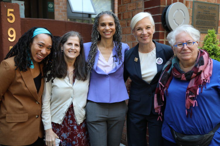 Maya Wiley smiling in a group photo with supporters, including Cecile Richards and Helen Rosenthal