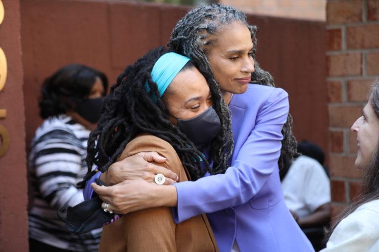 Maya Wiley side-hugs a supporter