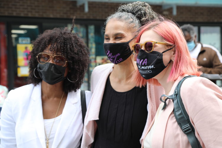 Maya Wiley takes a photo with two women