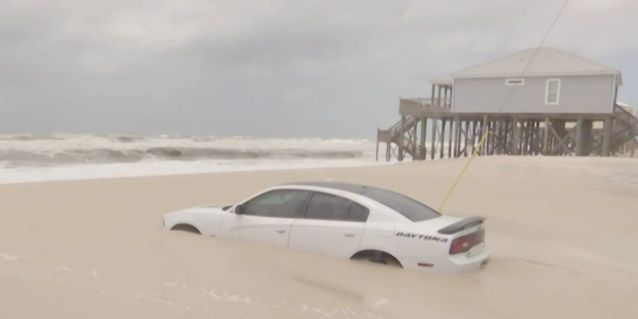 A car sank into the sand at an Alabama beach after its owner parked close to the shore ahead of Hurricane Barry