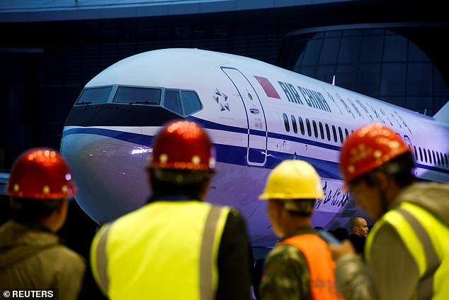 Boeing shares set to see $21 billion wiped off their value as firm POSTPONES launch of new 777X after China grounds ALL 96 of its 737 Max 8 planes following Ethiopian Airlines disaster that claimed 157 lives