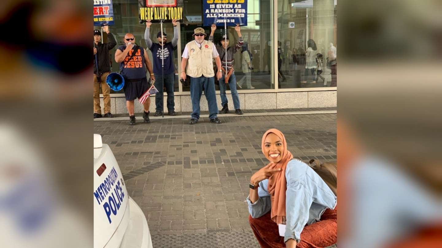 Muslim woman goes viral after posing in front of anti-Muslim protesters