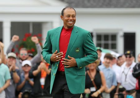 Woods jumps to sixth in rankings; Johnson reclaims No. 1