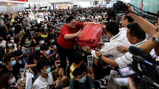 Riot police storm Hong Kong airport as protesters force second day of cancellations