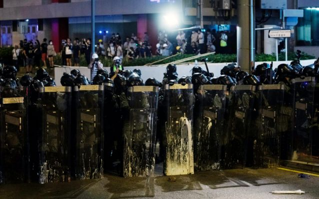China says Hong Kong will pay if protests continue in rare public statement