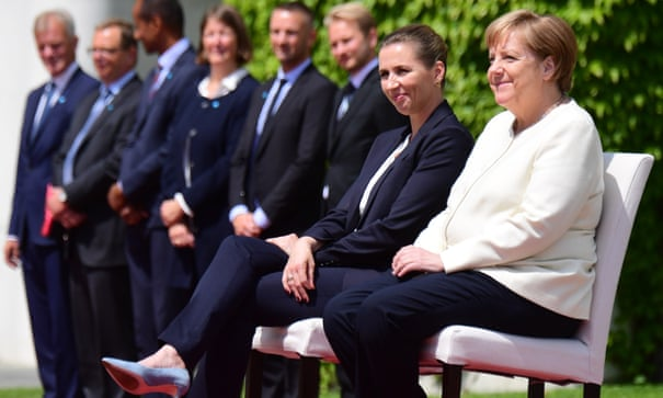 Angela Merkel sits for anthems after latest shaking episode German chancellor reportedly requests change of protocol after third bout of trembling