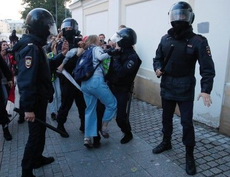 Viral clip of Russian policeman punching female protester stirs anger