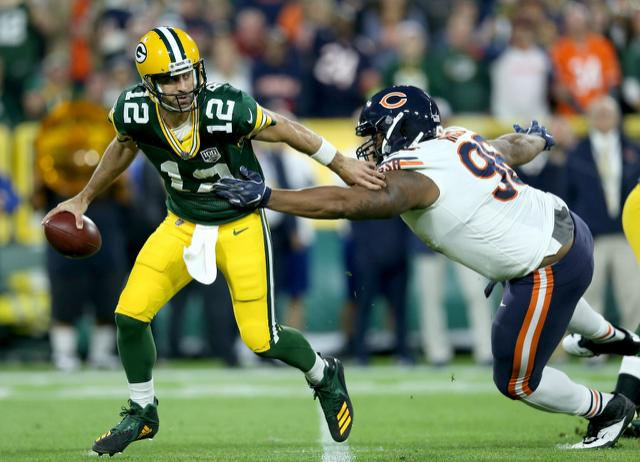 Aaron Rodgers, on ragged left leg, leads Green Bay to miracle win from 20-point deficit