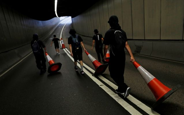 Hong Kong protesters are using lasers, traffic cones and parkour in battle with police