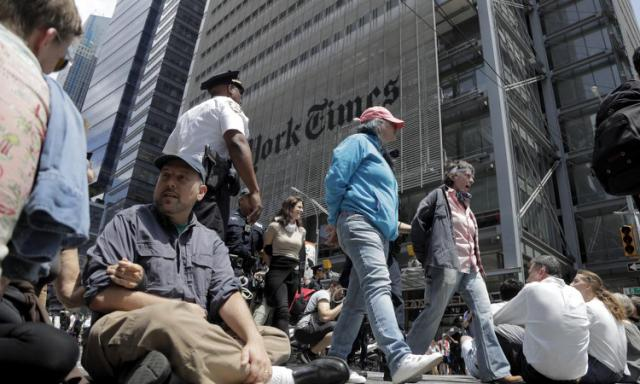 U.S. Arrests at protest over New York Times unacceptable climate coverage