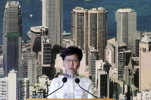 Hong Kong leader delays unpopular bill; activists want more