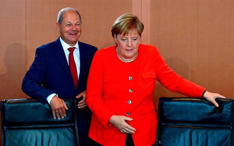 German finance minister Olaf Scholz warns of German Trump if pensions reforms not backed by Merkel