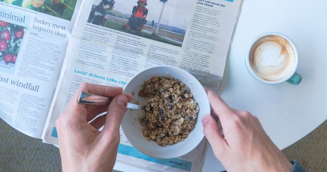 News - bowl of cereal on newspaper