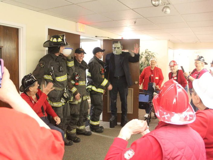 Peace Village Residents Share a Meal with Palos Fire Protection Station 2