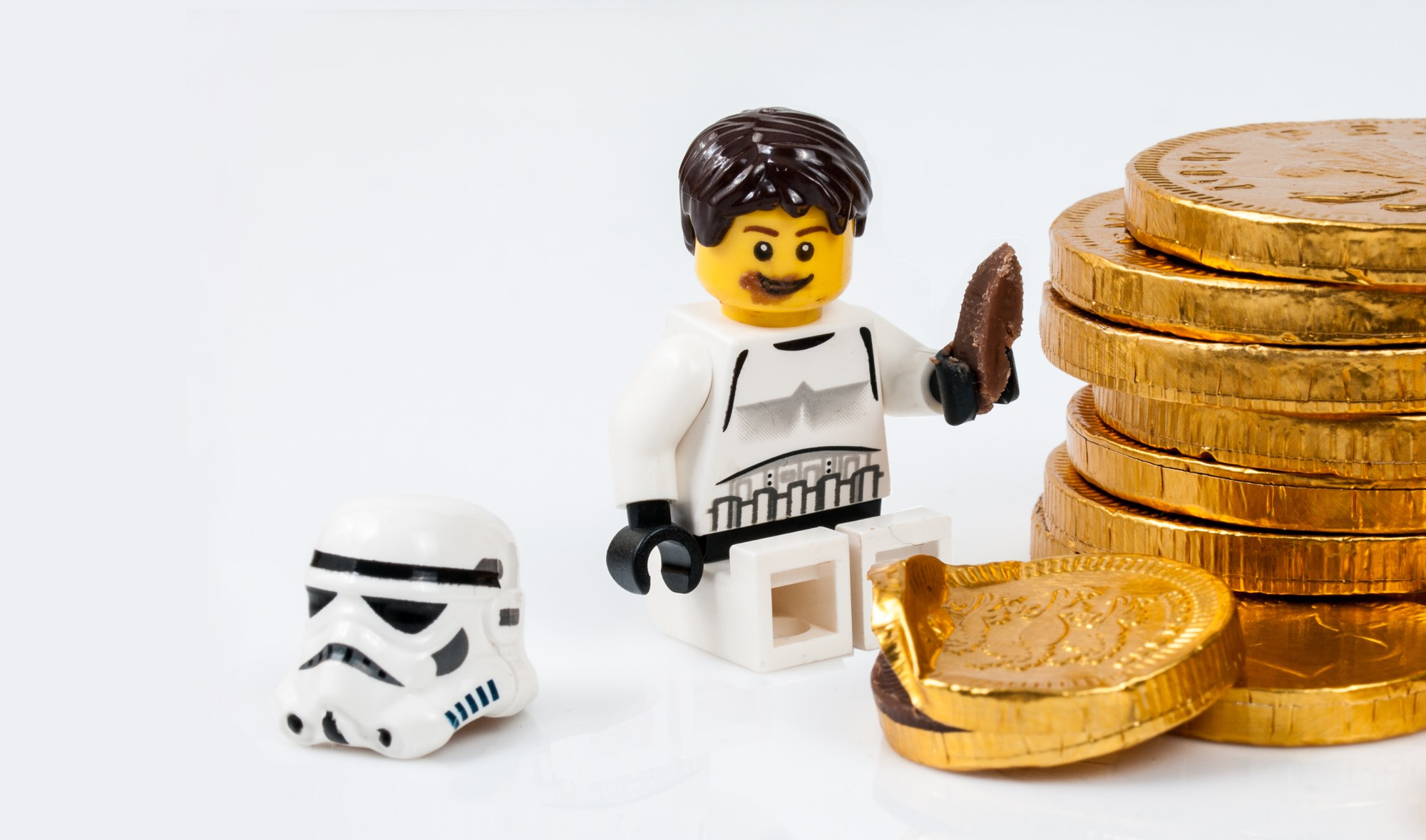 Lego storm trooper eating a chocolate coin