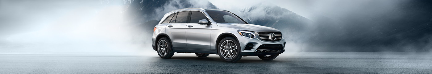 Mercedes-Benz GLC 300 parked on foggy mountain road