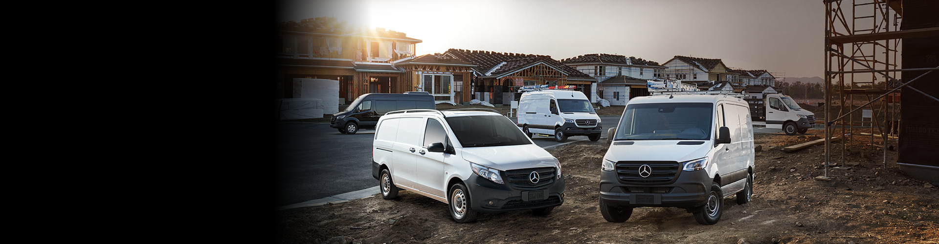 White Cargo Vans Parked at Construction Site