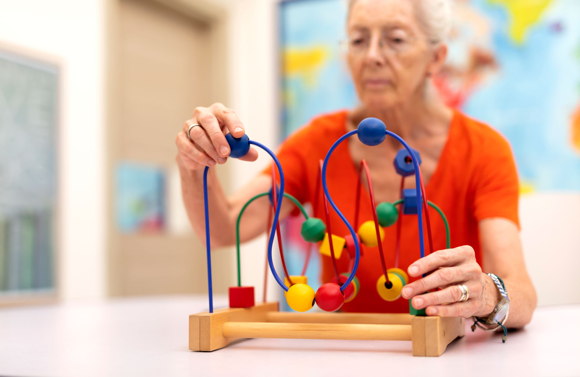 Senior woman using Montessori method
