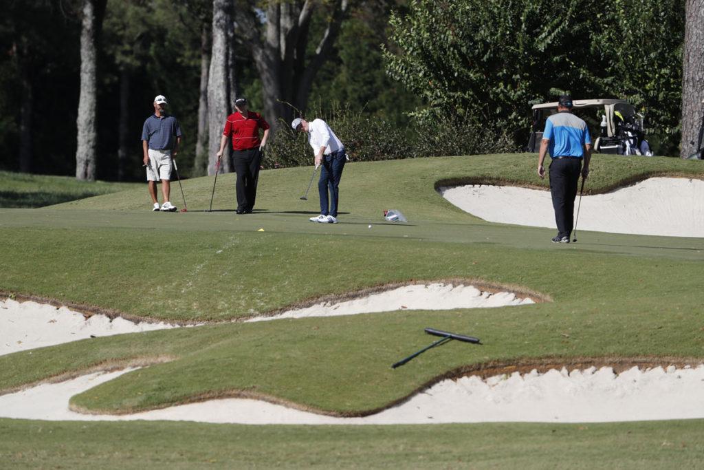 Seniors golfing together