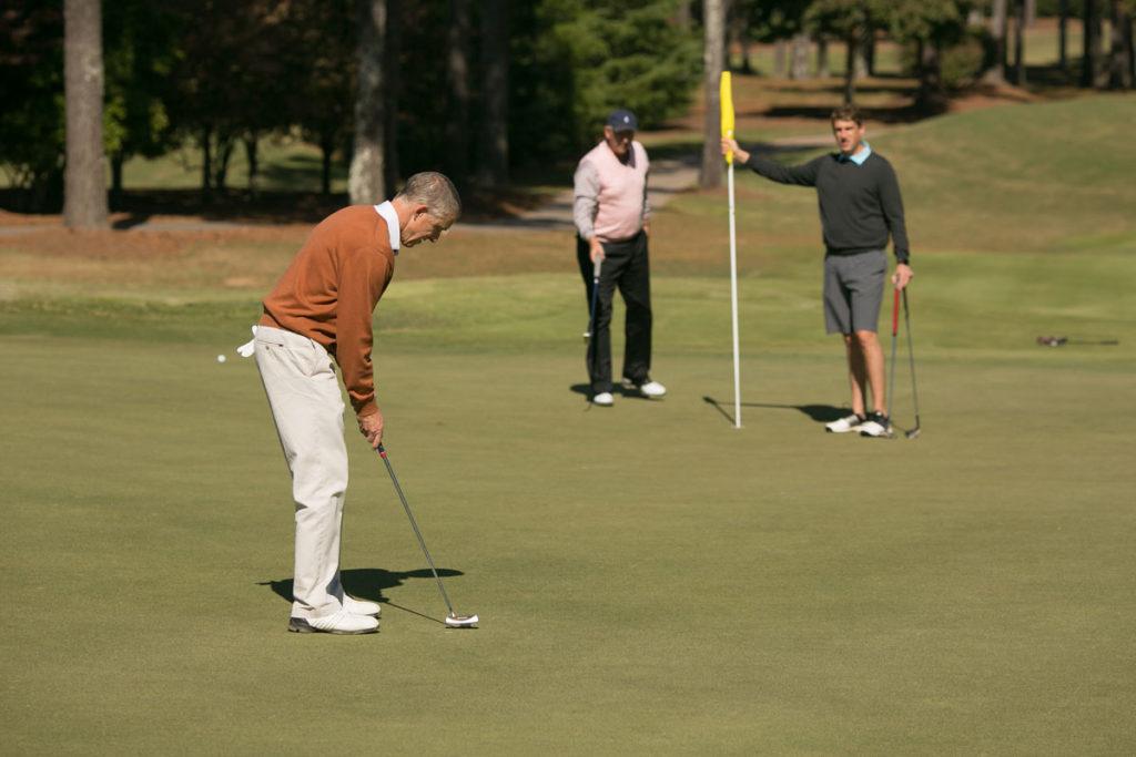 Group of senior men golfing together