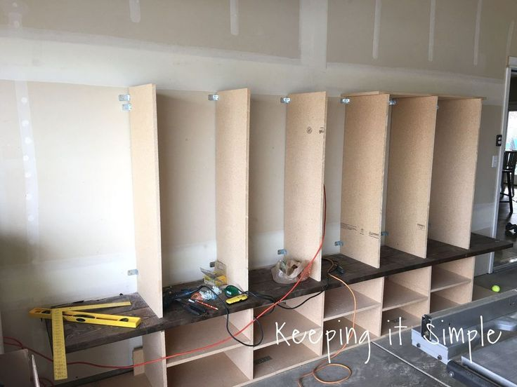 24 awesome diy garage projects diy garage mudroom lockers with lots of in my house we dont have any kind of coat closet mud room or even a hall closet so there is no place for our solutioingenieria Choice Image