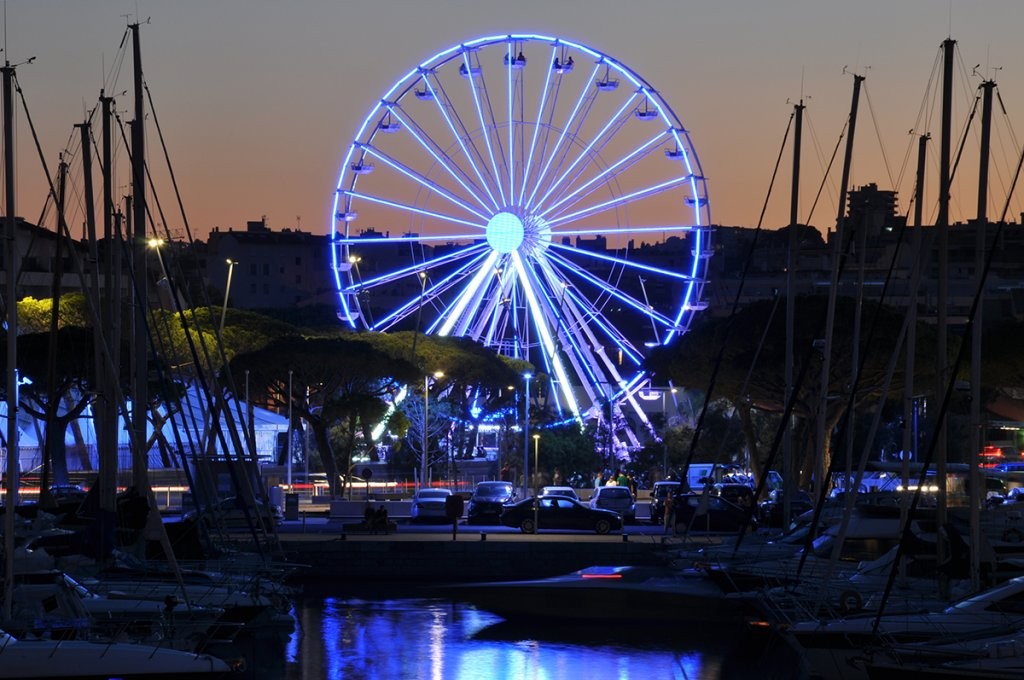 Night lights in the port of Antibes France, ferris wheel