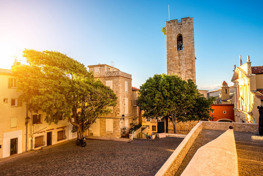 Central square with tower and church in Antibes