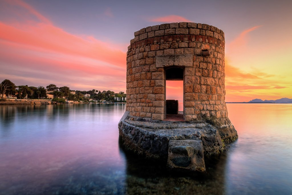 Ruins surrounded by water bay of Cap d'Antibes French Riviera
