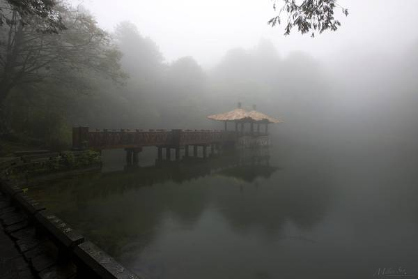 An Oriental Pavilion on the Pond in the Fog