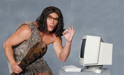 caveman with computer