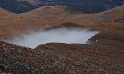 Slope of James Peak shrouded in cloud