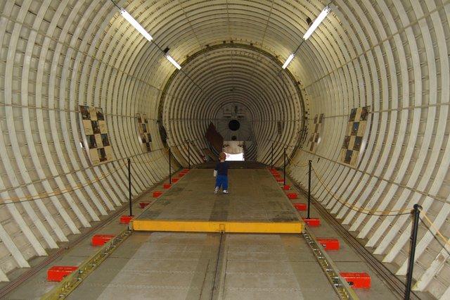 Calvin walks through the main cargo compartment of N422AU Super Guppy