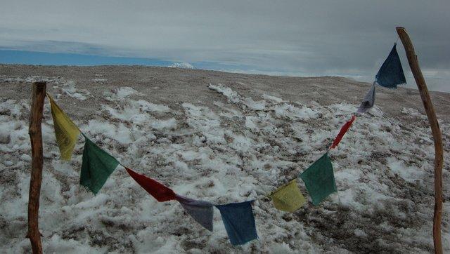 Summit prayer flags and Mount Rainier