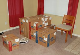 Boxes staging in the living room, waiting to be moved