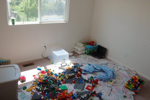 Calvin's room, mid-move, strewn with Duplos