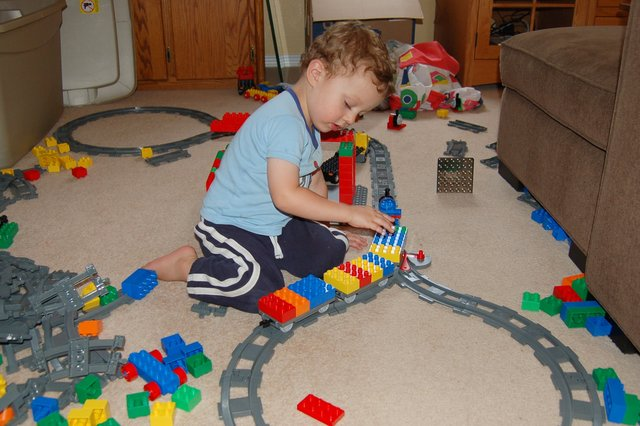 Calvin plays with the Duplo train