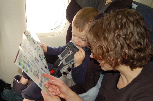 Kiesa and Calvin peruse the 777 safety card