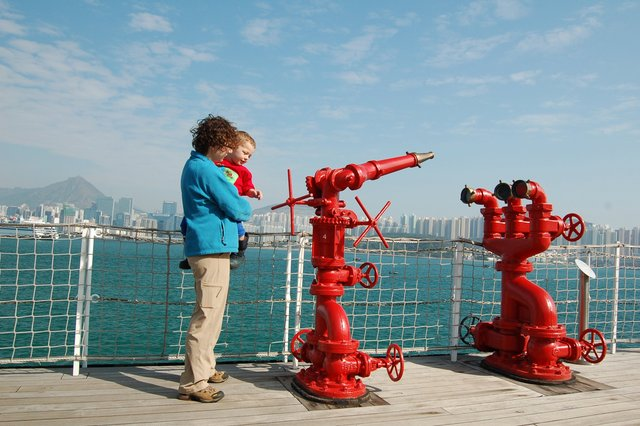 Kiesa and Calvin study the water cannons on the deck of the fireboat Sir Alexander Grantham