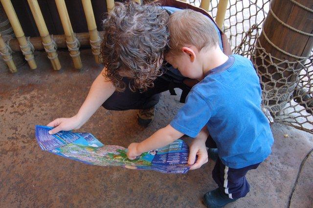 Kiesa and Calvin consult the Hong Kong Disneyland map