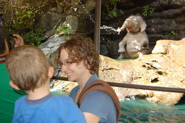 Calvin and Kiesa watch the animatronic elephant on the jungle cruise